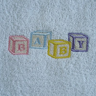 embroidered blocks on baby blanket
