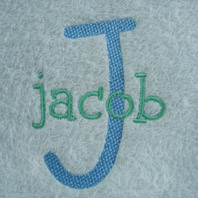 embroidered boys name on baby blanket with white trim