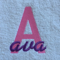 embroidered girls name in cursive on baby blanket with white trim