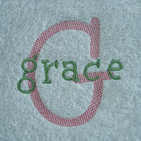 embroidered girls name on brown baby blanket