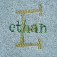embroidered name on baby blanket with blue trim