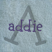 embroidered name on hot pink baby blanket