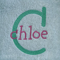 embroidered name on baby blanket with pink trim