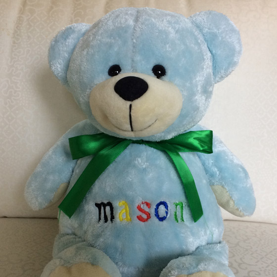 embroidered name on stuffed blue bear